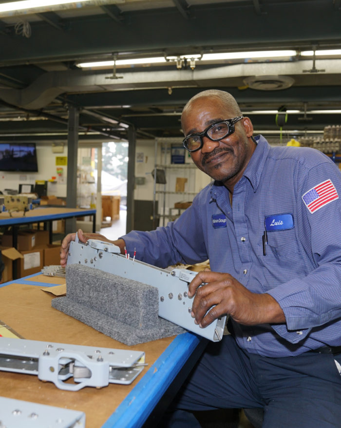 MEC Employee in Ejector Systems Assembly
